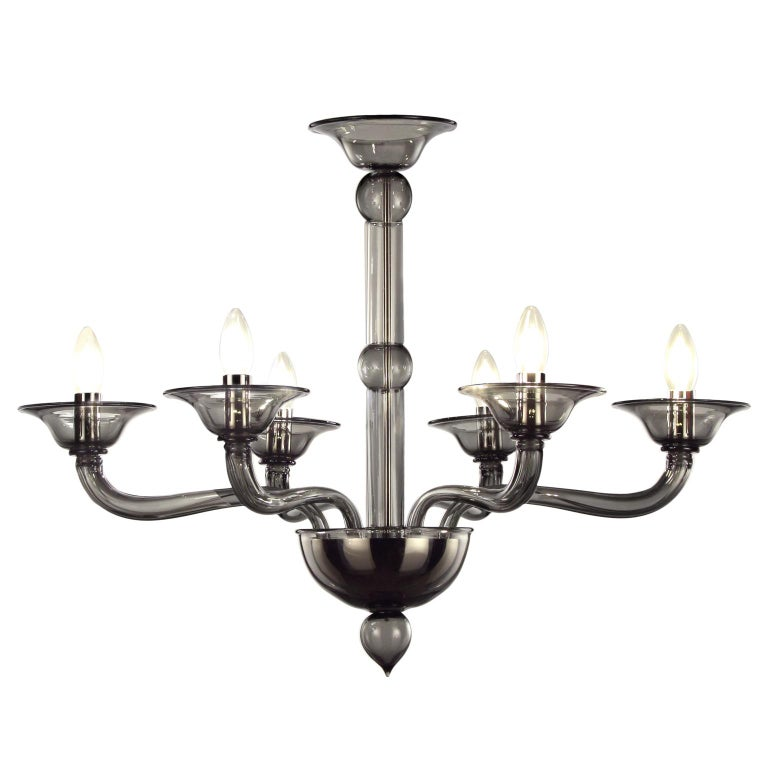 Multiforme Tobia chandelier 6 lights. Dark grey Murano glass with castle arms climbing arms. The blown glass chandelier Tobia harks back to the design typical of the first half of the 20th century. This lighting work is characterized by a