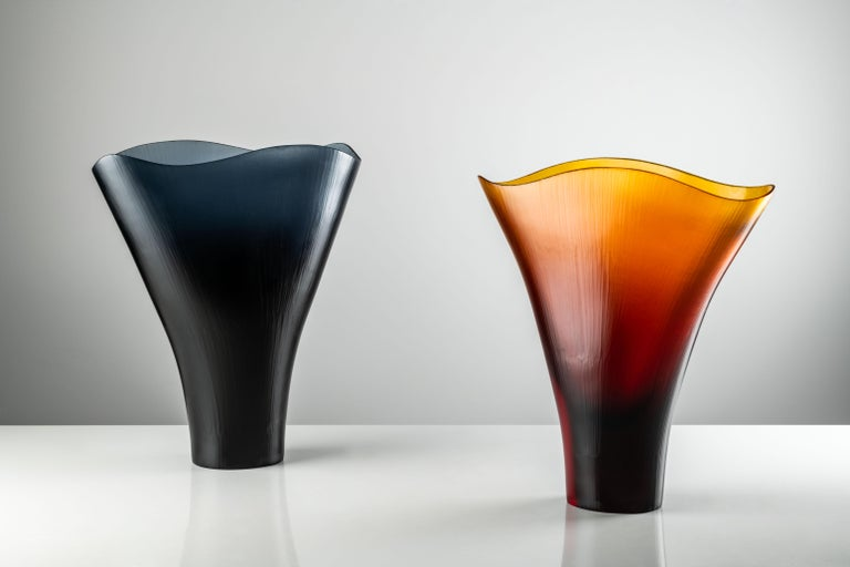 Battuti vase in Amber Murano glass by Tobia Scarpa and Ludovico Diaz De Santillana for Venini. It evokes a lily standing tall, in tones of Amber and Grape. Its translucent appearance is the result of the skill and hard work of the master