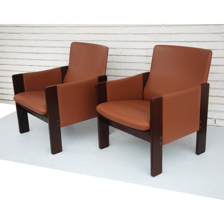A pair of Mid-Century Modern lounge chairs designed by Tobia Scarpa and made by Cassina. Rosewood frames with leather upholstery.