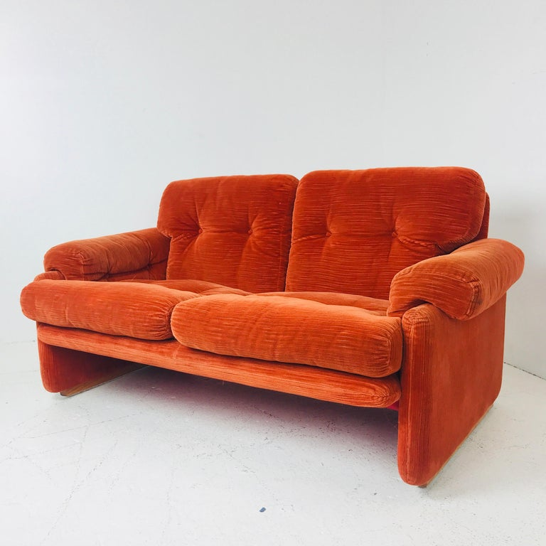 Orange Settee/Loveset by Tobia Scarpa for B&B Italia. Sofa is lightweight and in good vintage condition with original fabric, circa 1970s. Small tear in fabric on back of settee near foot.  Dimensions: 60w x 34d x 27h seat height 17