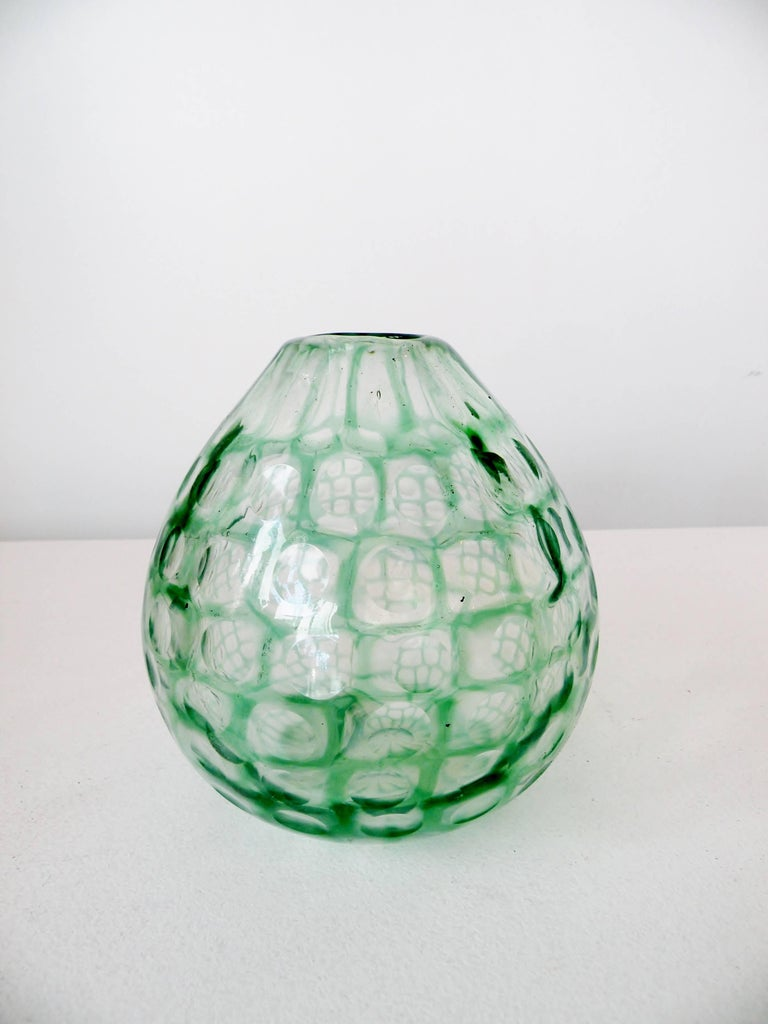 A scarce early 1960s Tobia Scarpa bulbous Occhi series vase. Green and clear art glass with cut disks around surface. Similar examples are illustrated in Le Verre Venini, Deboni, pl. 166.  This has light hard water rings from use to interior