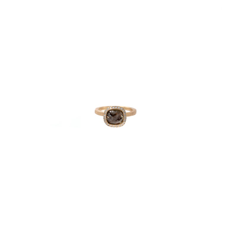 Exemplifying the hidden beauty within unpolished diamonds, Todd Reed transforms earth's natural elements into raw elegance.  Embellished with white diamonds, this one-of-a-kind red diamond is nestled in 18k rose gold.  Details: Red Fancy Cut Diamond