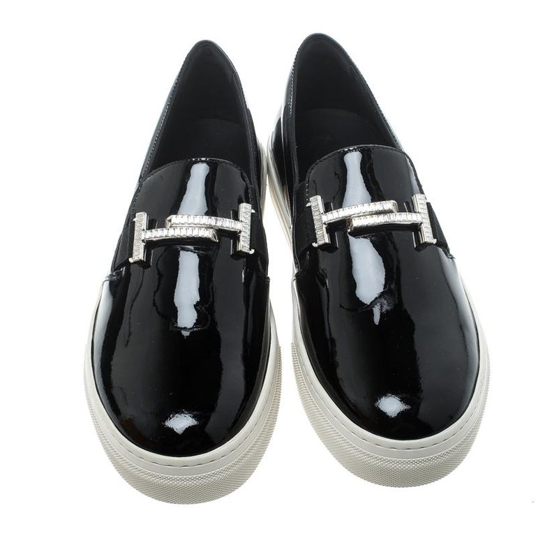 Exuding a bold and edgy style, these sneakers from Tod's are crafted with patent leather which is styled with silver-tone double T accents on the vamps to create a chic appeal. This pair comes with comfortable rubber soles and is easy to slip into.