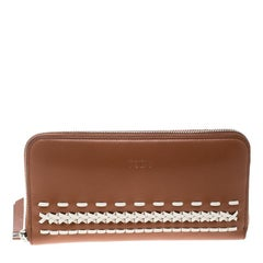 a7bf0aa3005aa7 Tod's Brown/White Leather Woven Detail Zip Around Continental Wallet