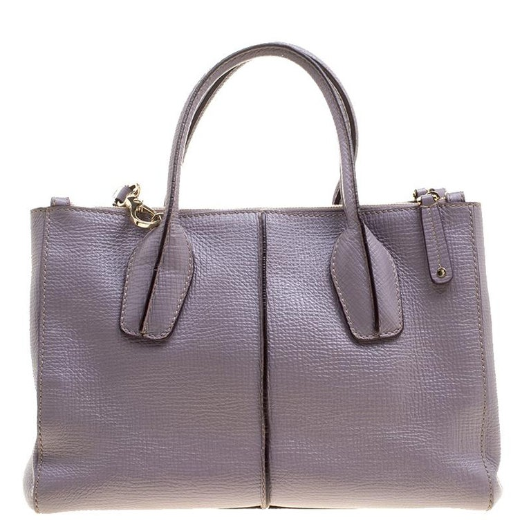 From the label of Tod's comes this lovely shopper tote that has been finely crafted from leather. It features double rolled handles, an adjustable shoulder strap and a spacious fabric interior to house your belongings.  Includes: The Luxury Closet