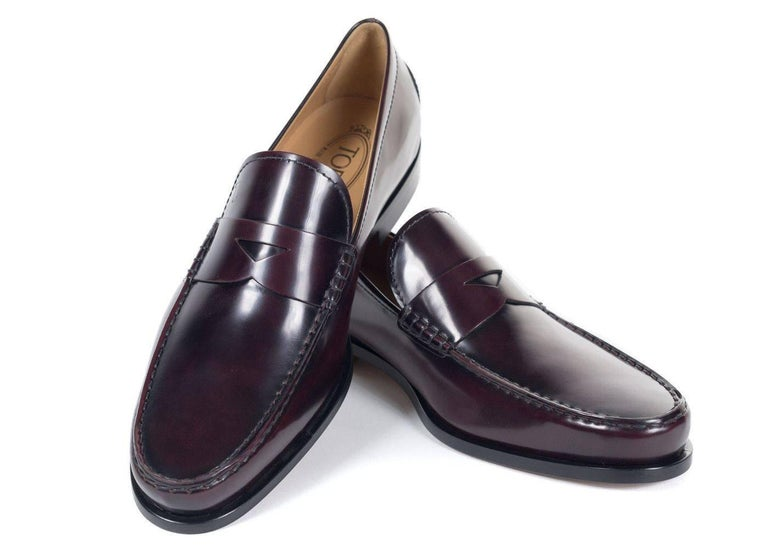 Brand new in Original Box and Dust Bag Retails in Stores and Online for $450 Size UK6 / US7 All Shoes are in UK Sizing  Richly polished burgundy leather shapes a refined penny loafer styled with a stacked heel and durable rubber sole. The Boston