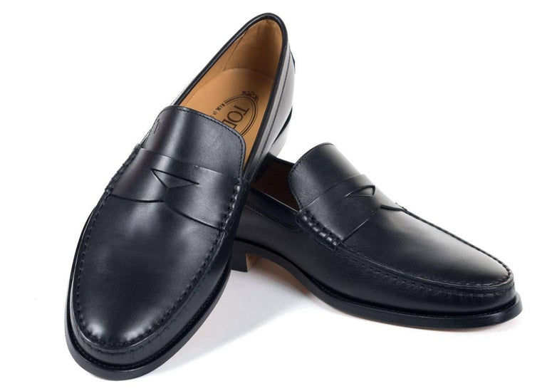 Brand New Tod's Men's Loafers Original Box & Dust Bag Included Retails in Stores & Online for $495 UK 6/ US 7 All Shoes are in UK Sizing  Tod's classic penny loafers crafted in black calfskin leather for an ultra smooth look to these shoes. These