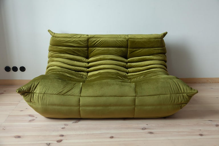 This two-seat Togo couch was designed by Michel Ducaroy in 1973 and was manufactured by Ligne Roset in France. It has been reupholstered in new olive green velvet (131 x 102 x 70 cm). It has the original Ligne Roset logo and genuine Ligne Roset