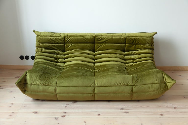 This vintage Togo three-seat sofa was designed by Michel Ducaroy in 1973 and was manufactured by Ligne Roset in France. It has been reupholstered in new olive green velvet (70 x 174 x 102 cm). It has the original Ligne Roset logo and genuine Ligne