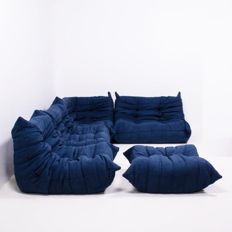The iconic Togo sofa, originally designed by Michel Ducaroy for Ligne Roset in 1973, has become a design Classic.   This five piece modular set is incredibly versatile and can be configured into one large corner sofa or split for a multitude of