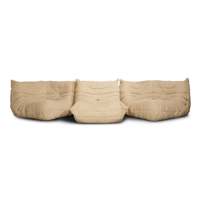 This timeless French design classic Togo corner seat from Ligne Roset by Michel Ducaroy, designed in 1973, is upholstered in a gorgeous beige Alcantara ultrasuede. This classic ergonomic design, which is highly coveted by top designers, is produced