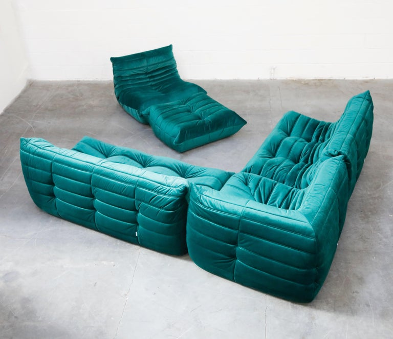 This incredible five (5) piece Togo sectional living room set, was designed by Michel Ducaroy in 1973 for Ligne Roset, France. This set was completely restored with new high grade velvet upholstery in a mesmerizing emerald green color, and bottom