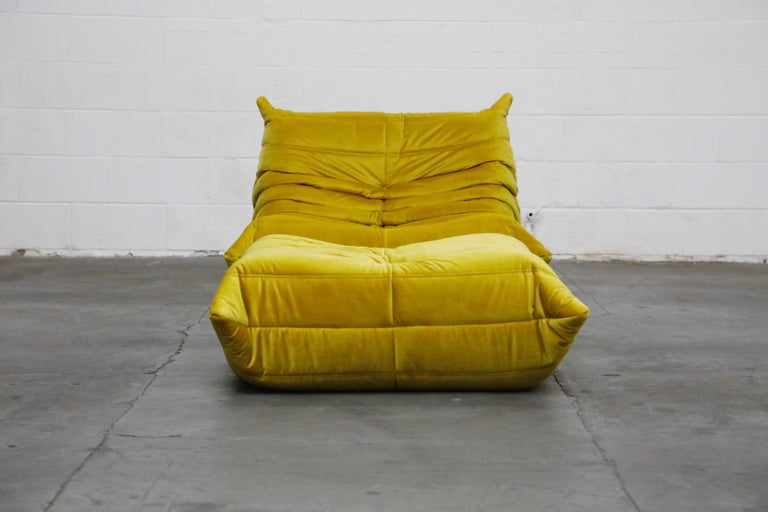 This incredible 'Togo' fireside lounge chair and ottoman was designed by Michel Ducaroy in 1973 for Ligne Roset, France. This set was completely restored with new high grade velvet upholstery in a mesmerizing golden chartreuse color, and bottom
