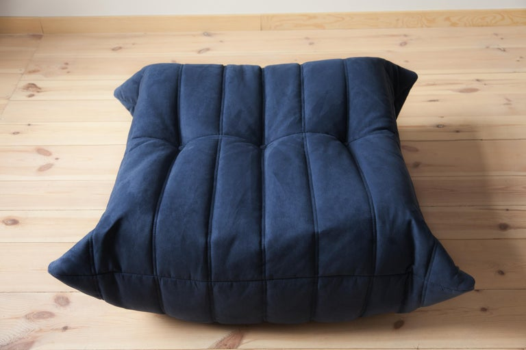 This Togo ottoman was designed by Michel Ducaroy in the 1970s and was manufactured by Ligne Roset in France. It has been reupholstered in new dark blue microfibre (87 x 80 x 38 cm). It has the original Ligne Roset logo and genuine Ligne Roset bottom.
