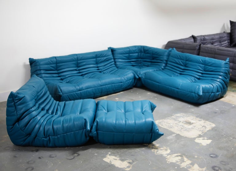 This incredible five (5) piece Togo sectional living room set, was designed by Michel Ducaroy in 1973 for Ligne Roset, France. This set was completely restored with new high grade Bovine leather upholstery in a mesmerizing Petrol Blue color, and