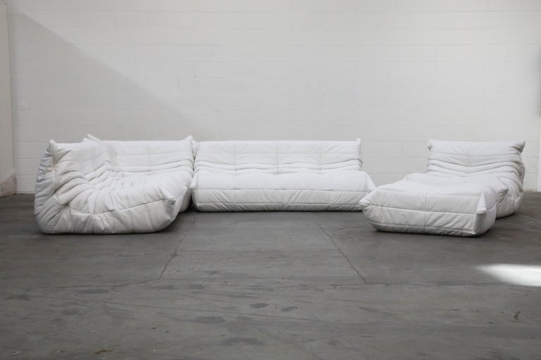 This incredible five (5) piece Togo sectional living room set, was designed by Michel Ducaroy in 1973 for Ligne Roset, France. This set was completely restored with new high grade leather in a bright Icelandic white color, and bottom decking fabric