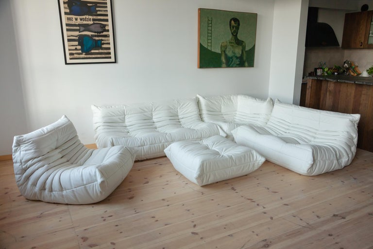 This Togo living room set was designed by Michel Ducaroy in 1973 and was manufactured by Ligne Roset in France. It has been reupholstered in new, great quality white leather and is made up of the following pieces: One three-seat couch (70 x 174 x
