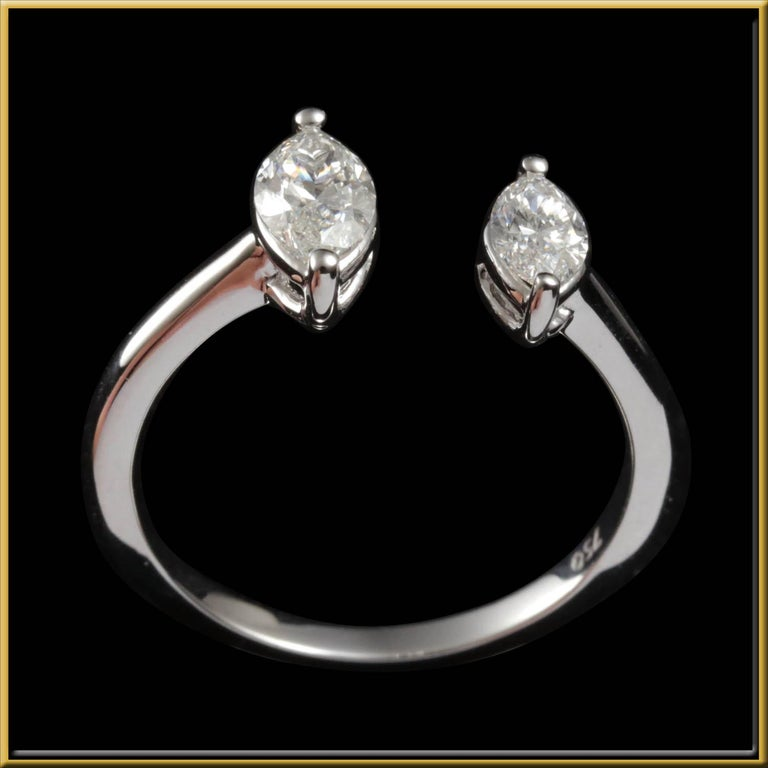 Diamond Fashion Ring, in the Toi et Moi concept, using a 0.3ct and 0.4ct marquise cut diamond, on a plain gold band create this ring. This ring is perfect for everyday wear, and is very attractive and statement - worthy.   The piece is crafted in -