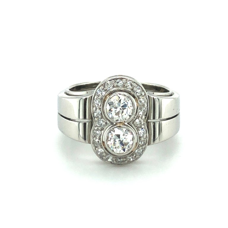 This charming Toi et Moi ring is set with two beautiful Old European Cut diamonds of H/I colour and vs/si clarity, total weight approximately 0.70 carats. The entourage is set with 20 old single-cut diamonds of H/I colour and si/i clarity, total