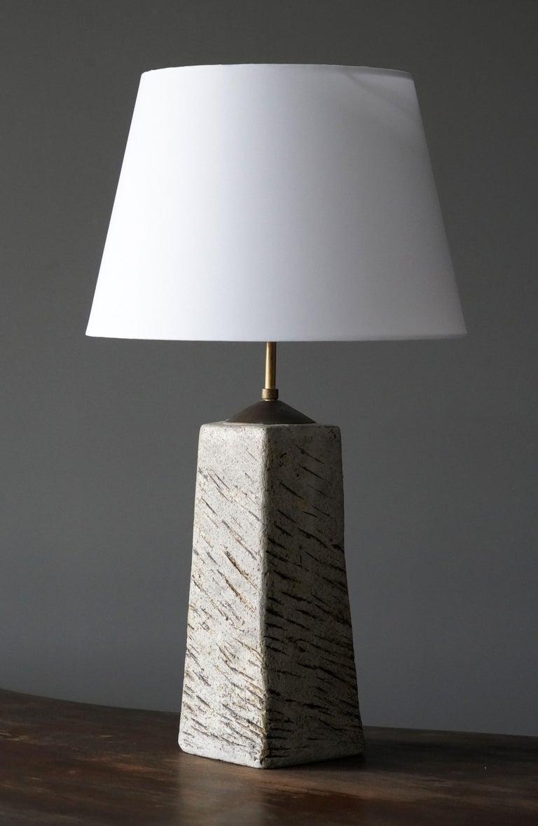 A table lamp, likely unique, by Finnish ceramic artist Toini Muona (1904 - 1987).   Sold without lampshade. Stated dimensions excluding lampshade.