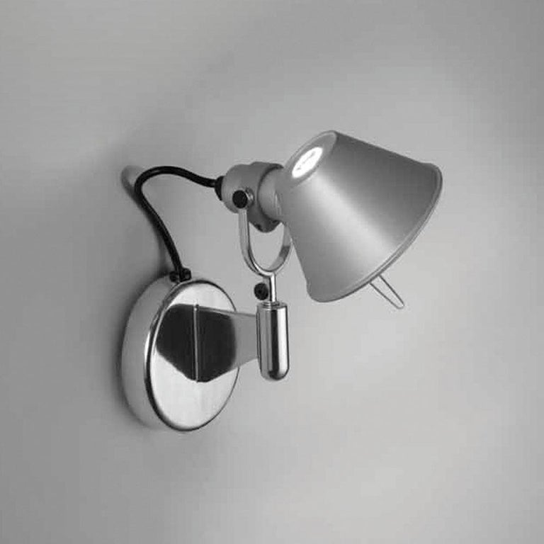 An extension to the iconic Tolomeo family, Tolomeo wall spot combines the head of the Tolomeo table lamp with a wall support to allow for a wall spot lighting solution offering flexibility and style.  Materials: Fully adjustable rotatable and