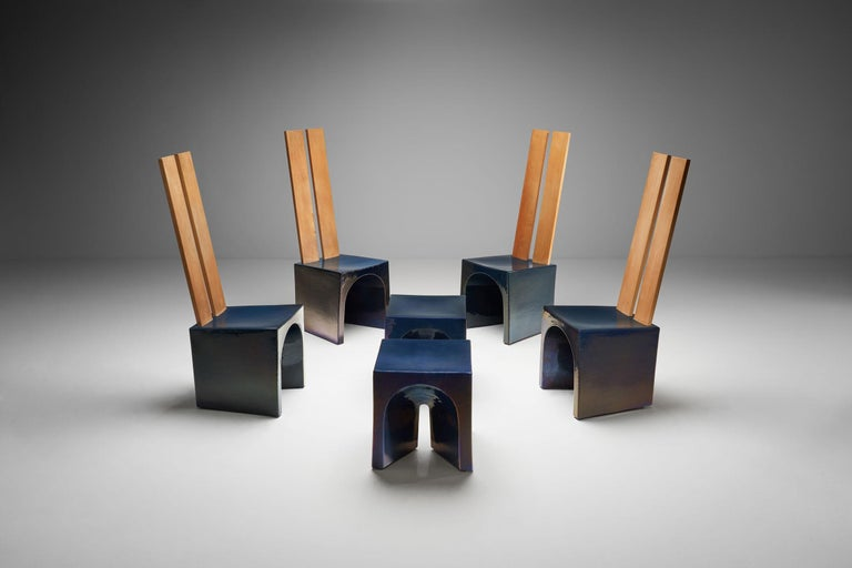 This set of four elemental chairs and two tables is a beautiful example of the collaboration between Dutch designer Tom Bruinsma and Mobach ceramics, circa 1980s. These fully glazed ceramic pieces appear in a variety of colors depending on the angle