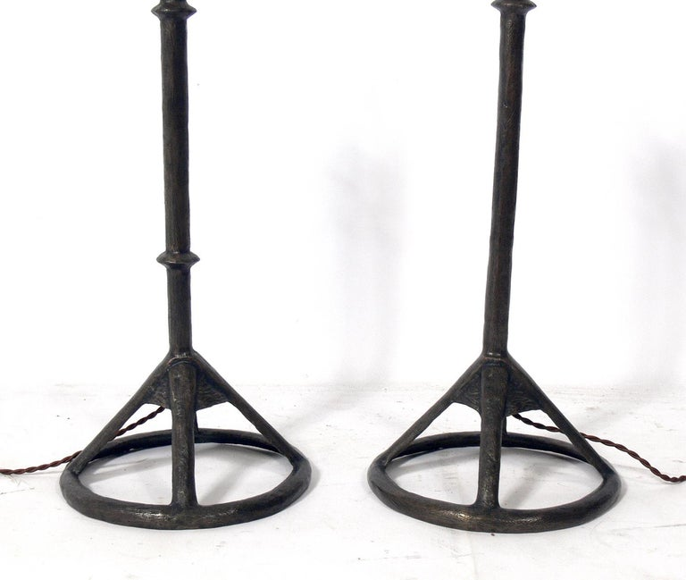 Solid bronze table lamps, made by Tom Corbin, American, circa 2000s. They retain their warm original patina. Corbin's work was clearly influenced by Diego Giacometti. The lamps have been rewired with cloth cords and the shades are included in the