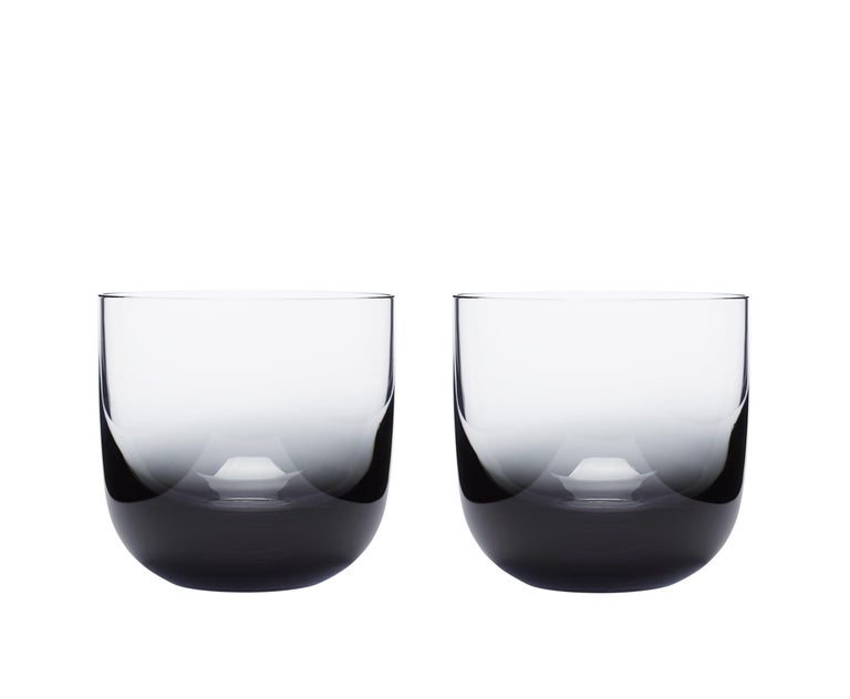 In black, tank sets a mysterious and indulgent tone to our glassware collection. Created through a technically demanding fusion of clear and solid black glass, Tank is mouth-blown into the graphic forms for timeless tabletop architecture.  The