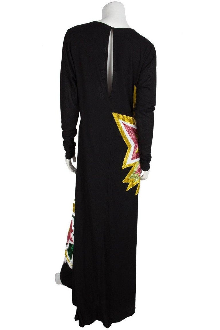 Tom Ford Black Light Knit And Multi Color Beaded Starburst Long Sleeve Maxi Dress. Extra Top Layer Wraps Around Back. Keyhole Detail On Back With Hook Closure At Top. From The 2013 Collection. 100% Nylon. Made In Italy. Minor Wear. Few Loose Beads.