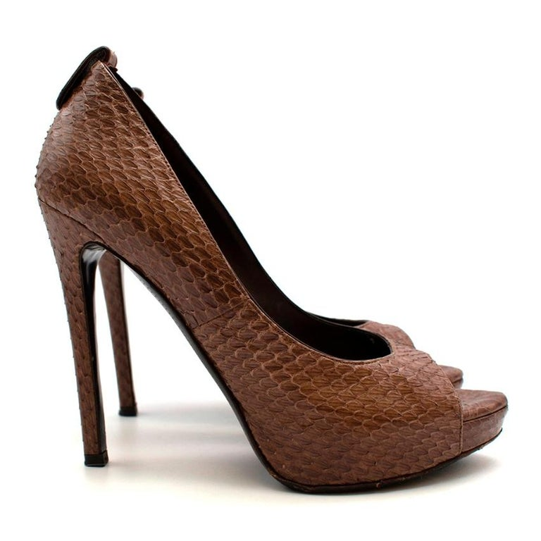 Tom Ford Brown Snakeskin Peep Toe Platform Pumps  -Luxurious snake skin texture  -Gorgeous neutral brown hue  -Classic timeless design  -Easy styling  -Soft leather lining  -Stiletto heels   Materials: Main-snakeskin  Lining-leather  Soles-leather