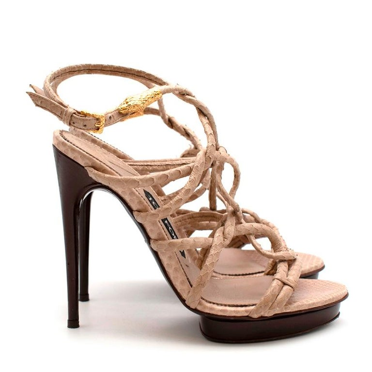 Tom Ford Cream Snakeskin Strappy Heeled Platform Sandals   -Luxurious snakeskin  -Soft leather lining  -Knot like details to the front  -Brown patent leather to the heels and platform  -Golden snake head detail to the ankle strap