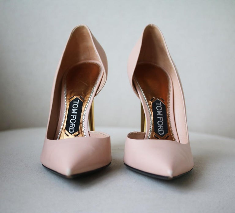 TOM FORD's Italian-made leather pumps have a flattering d'Orsay-style cutout and sleek pointed toe. The versatile nude shade is complemented perfectly by the brand's signature gold heel. Gold heel measures approximately 101 mm/ 4 inches. Nude-pink