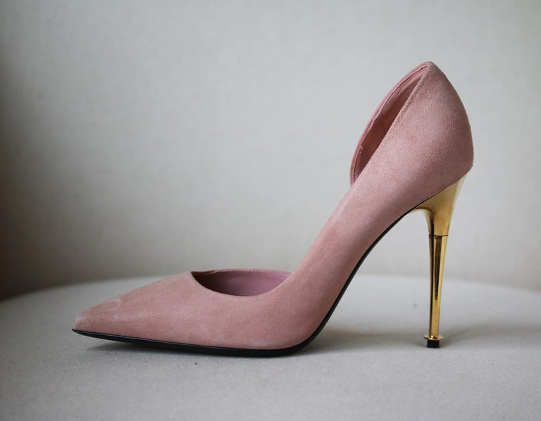 TOM FORD's Italian-made suede pumps have a flattering d'Orsay-style cutout and sleek pointed toe. The versatile nude shade is complemented perfectly by the brand's signature gold heel. Gold heel measures approximately 101 mm/ 4 inches. Nude-pink