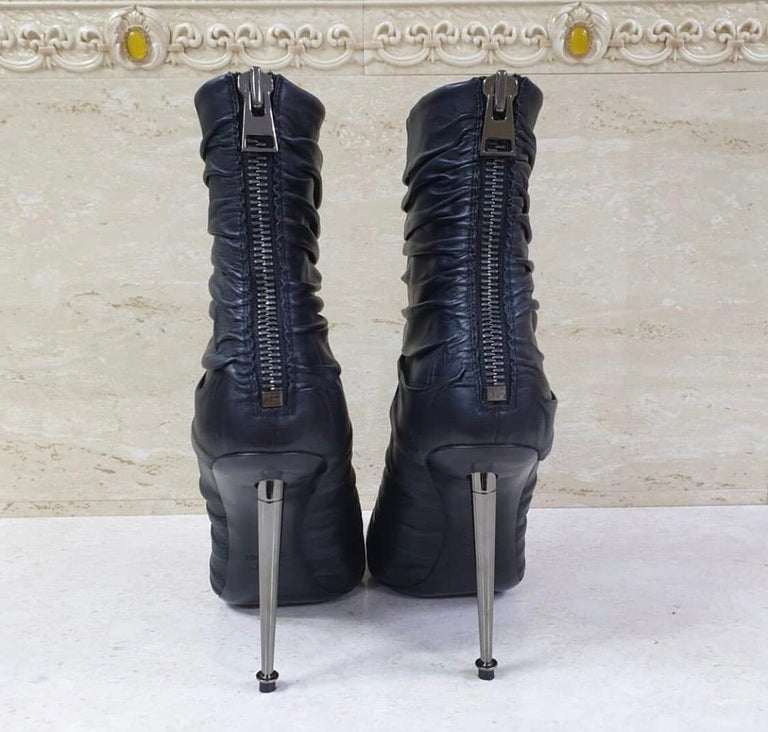 Black draped leather pointed-toe booties with metal spike heel and back zipper from Tom Ford.  Condition is very good.  Sz. 39  No original packaging