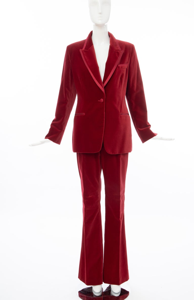 Tom Ford for Gucci, Autumn-Winter 1996, crimson cotton velvet pantsuit. Jacket features dual welt pockets at waist, slit pocket at bust, contrast panel at collar and single button closure at front. Pants feature dual slit pockets at waist, dual welt