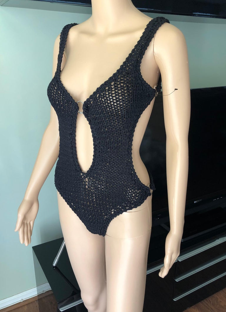 Tom Ford for Gucci S/S 1995 Runway Cutout Knit Woven Black One-Piece Bodysuit Swimsuit IT 42  Gucci knitted woven one-piece swimsuit featuring plunging neckline, cutout accents and open back.