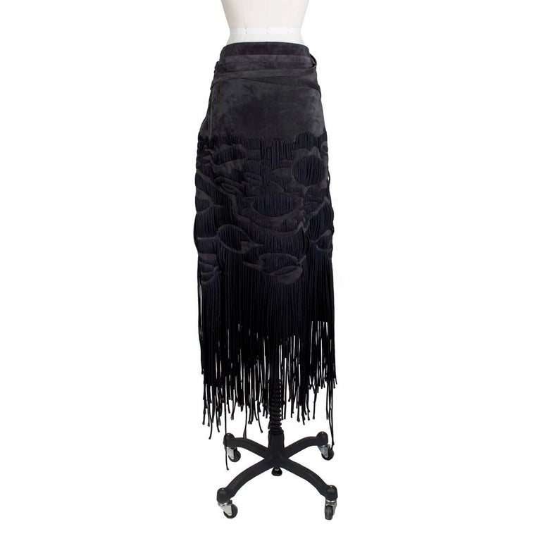 Skirt by Tom Ford for the YSL F/W 2001 RTW collection Faded black suede with black nylon cord fringe woven throughout Attached suede belt tie for waist Condition:  Great, with some minor wear to the suede Size/Measurements: Size 38 29