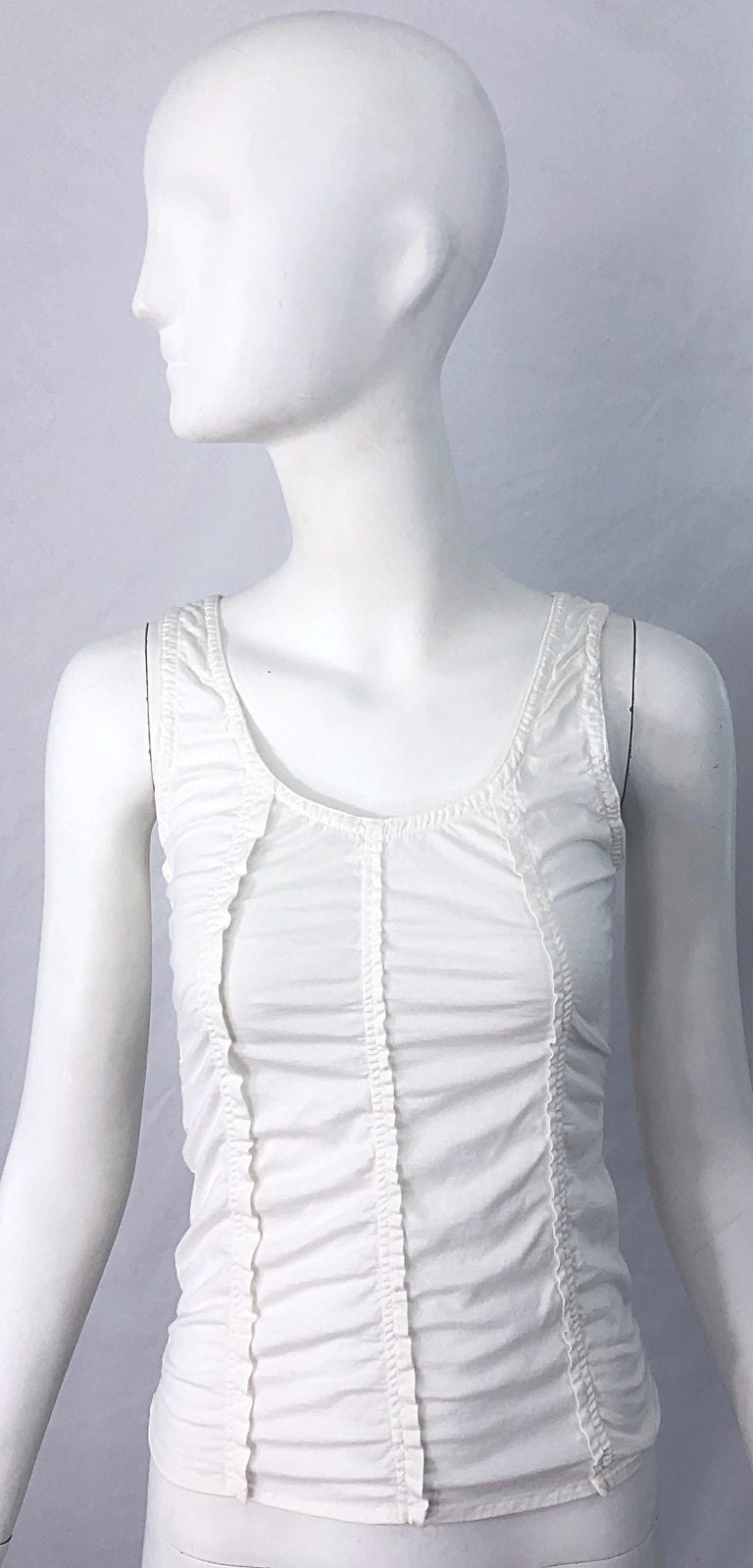 The perfect white tank! TOM FORD for YVES SAINT LAURENT white cotton sleeveless tank top shirt ! Features flattering vertical rows of ruffles down the front and back. Simply slips over the head, and stretches to fit. Can easily be dressed up or