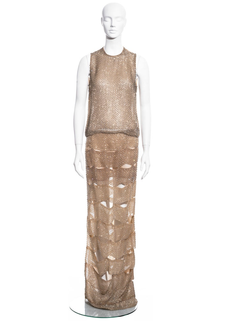 ▪ Tom Ford evening dress comprising; skirt and top   ▪ Constructed with nude silk organza and a lattice of glass beads  ▪ Skirt formed from pieced strips   ▪ Matching bodice with sheer back panel ▪ IT 40 - FR 36 - UK 8 - US 4  ▪ Spring-Summer 2013