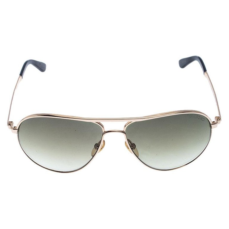 Choose these stunning sunglasses and escalate your style quotient. The Marko TF144 is Tom Ford's take on the iconic aviator shape. Contemporary in aesthetics, with rose-gold metal frame and green gradient lenses which make this a great option for