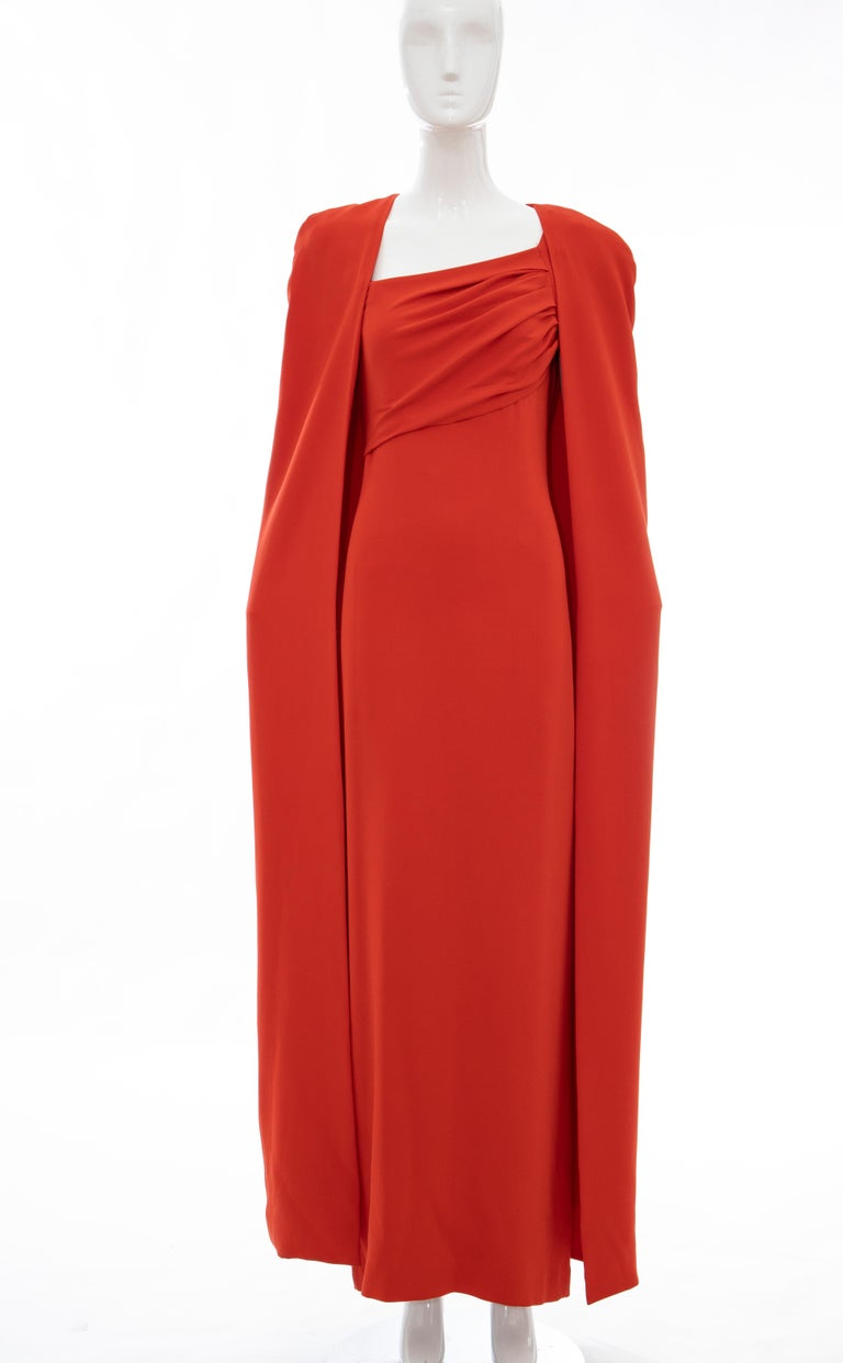 Tom Ford Runway Fall 2012, silk persimmon evening dress ensemble. Cape features tonal stitching throughout, open front and fully lined in silk. Dress features cap sleeves, gathering at bodice, slit at back, concealed back zip closure and fully lined