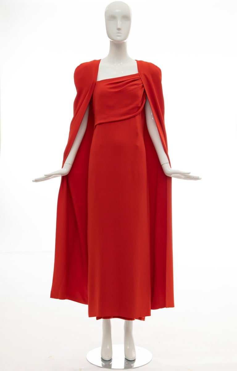 Tom Ford Runway Fall 2012, silk persimmon evening dress ensemble. Cape features tonal stitching throughout, open front and fully lined in silk. Dress features cap sleeves, gathering at bodice, slit at back and concealed zip closure at back and fully