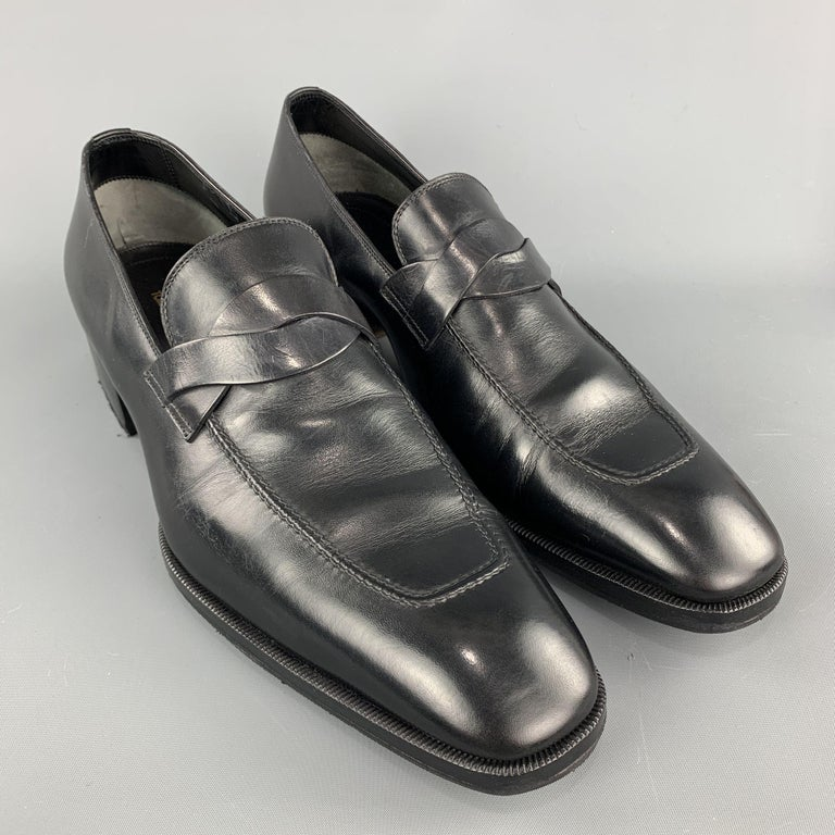 Retailed: $1850.00.  TOM FORD loafers comes in a black leather featuring a slip on style, elkan twisted band detail, and a wooden heel. Made in Italy.  Excellent Pre-Owned Condition. Marked: 12.5 TT  Measurements:  Length: 13 in. Width: 4 in.  Heel: