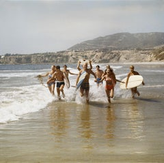 Surfers with Surfboards