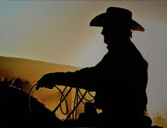 Carbondale Cowboy (Colorado western cowboy on his horse at the Rodeo at sunset.)