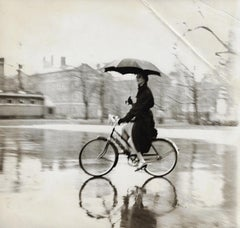 Anne St. Marie on Bike with Umbrella