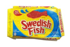 """Red yellow and blue hyperrealist sculpture, """"Swedish Fish"""", acrylic on wood"""