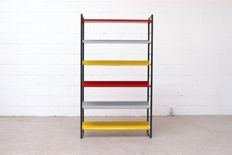 From famed Dutch Manufacturer Tomado (An acronym for Van der TOgt Massa Artikelen DOrdrecht meaning Van Der Togt Mass Articles Dordrecht - Dordrecht being the city the company originated from) comes this enameled metal standing book shelf with