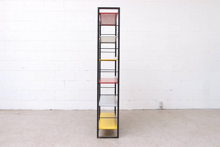 Mid-Century Modern Tomado Multicolored Enameled Metal Standing Book Shelf For Sale