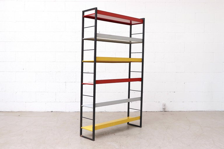 Dutch Tomado Multicolored Enameled Metal Standing Book Shelf For Sale